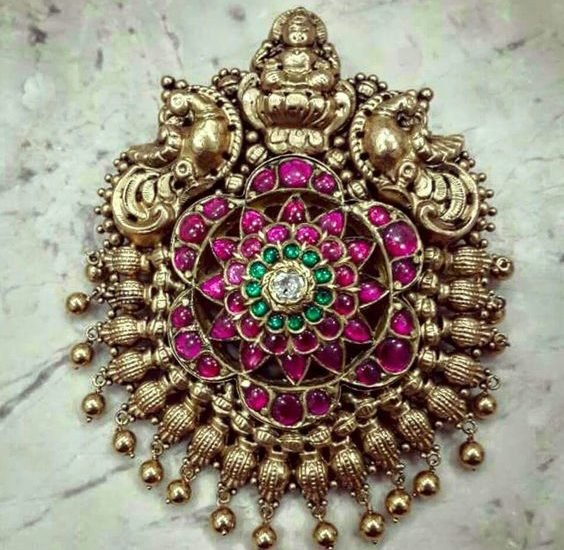 lakshmi and peacock carved antique ruby pendant