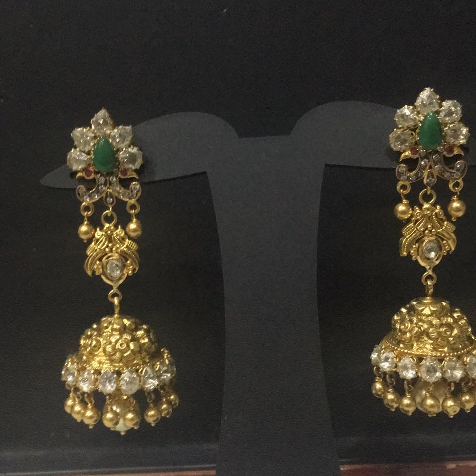 uncuts and emerald jhumkis from maruti jewellers